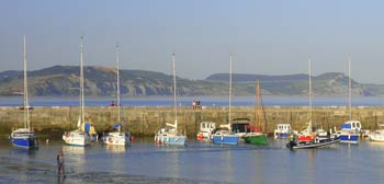View across the harbour to Stonebarrow and Golden Cap